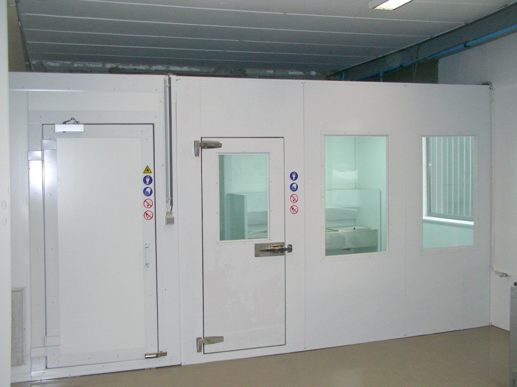 Paint mixing booth next to a storage room