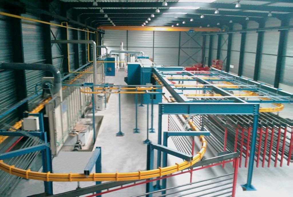 Coating line with powered overhead conveyor