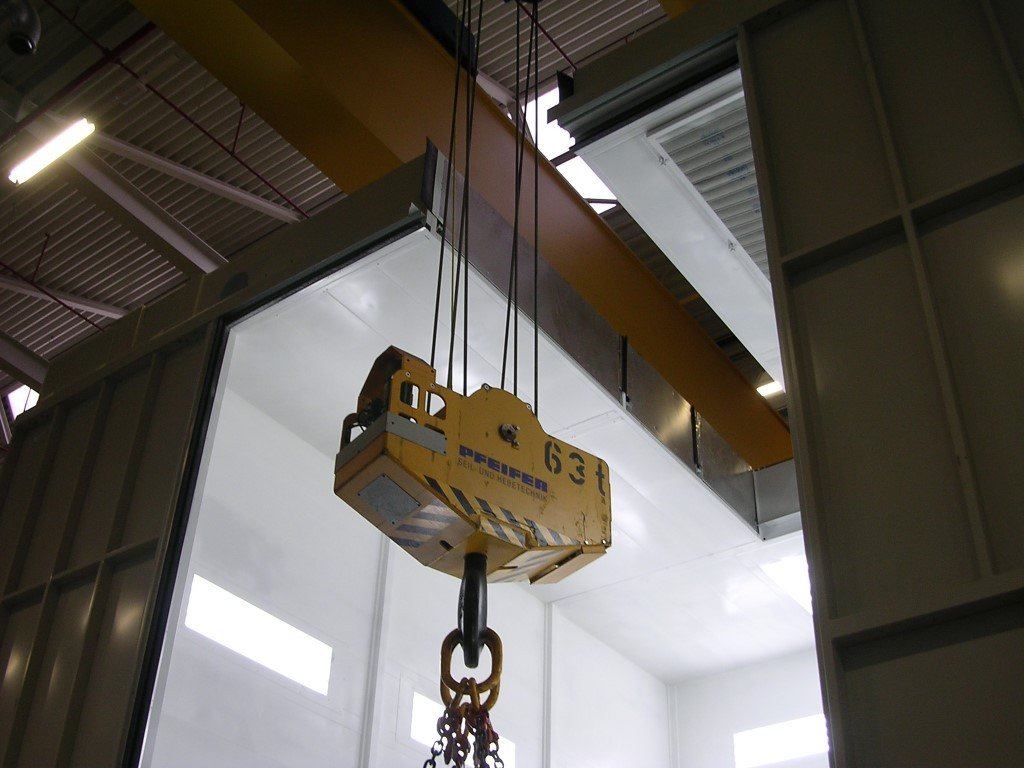 Groove in the ceiling to bring in heavy pieces with a overhead travelling crane