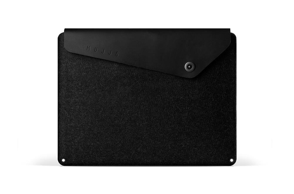 https://dpyxfisjd0mft.cloudfront.net/lab9-2/Producten/Mujjo/mujjo-mba-sleeve-black.png?1423920073&w=1000&h=660