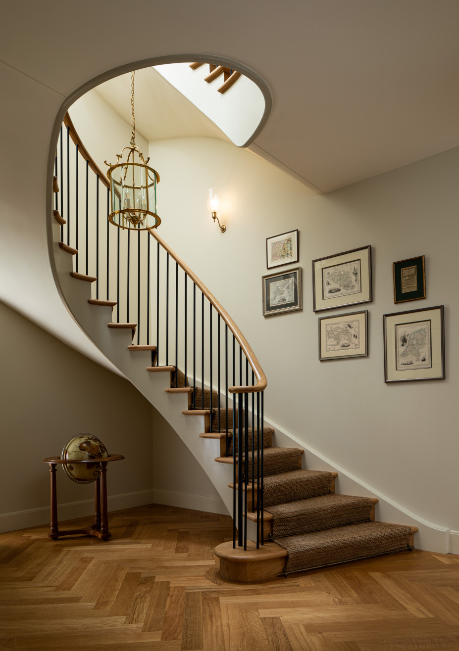 Wooden staircase with glass railing