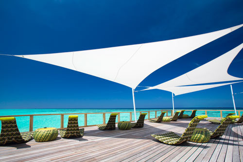 Sun shadesails in combination with dedon design furniture