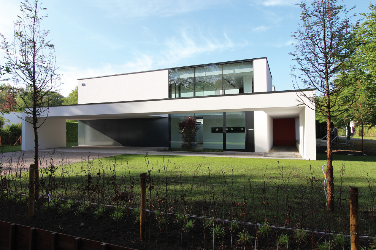 Een gesloten gevelsysteem? Decoratief én isolerend! fijne-korrel-witte-villa.jpg